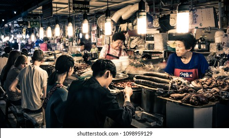 Seoul, South Korea - May 11, 2017: Customers enjoying korean's traditional foods at GwangJang Market at night.