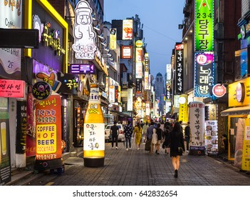 SEOUL, SOUTH KOREA - MAY 13, 2017: People wander in the busy streets of the Insadong entertainment district lined with bars and restaurants at night.