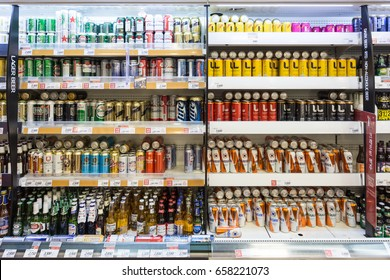 SEOUL, SOUTH KOREA - MAY 13, 2017: Beer cans and bottle, both domestic and imported brands such as Cororna and Budweiser, are  displayed in a supermarket in Seoul in South Korea.