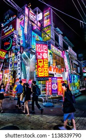 Seoul, South Korea - May 14, 2017: Big crowd of tourists and locals are shopping and walking at hongdae street market at night. The mood is fantastic.