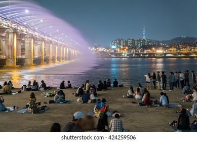 Seoul, South Korea - May 14, 2016: A night view of Banpo Bridge, Seoul city with Rainbow Fountain Show