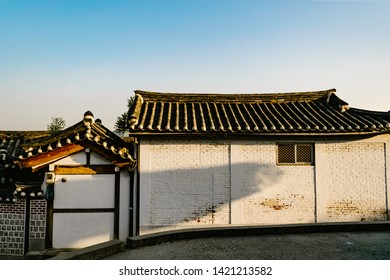 SEOUL, SOUTH KOREA - May 16, 2019 : The traditional Korean style house at Bukchon Hanok Village with sunlight   and blue sky.