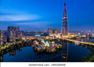 Seoul, South Korea - May, 2019: Aerial Night view of Lotte world tower and Seokchon lake park in Seoul city.