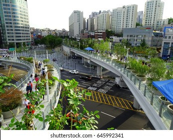 Seoul, South Korea, May 20,2017, Hundreds of people are walking around on the opening day of Seoullo 7017 which is the pedestrian road of the Seoul Station Overpass