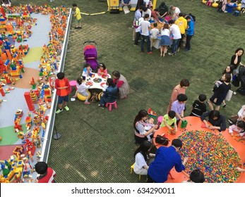 SEOUL, South Korea, May 4,2017, Hundreds of people are playing lego block around seokchon lake park and lotte world tower