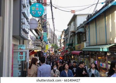SEOUL, SOUTH KOREA - MAY 6, 2017: Many people visit Hongdae shopping street. Hongdae is shopping famous tourist destination paradise in Seoul, Korea.