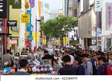 Seoul, South Korea - May 7, 2016: Myeong-Dong shopping street, people tourists walking shopping the neighborhood. It is fashionable to be the most popular.