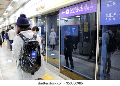 """SEOUL, SOUTH KOREA - NOVEMBER 11 : Girl walking in the Metropolitan Subway of Seoul with a backpack where a label is attached with text:""""Put it back, it's mine"""", November 11, 2015, Seoul, South Korea."""
