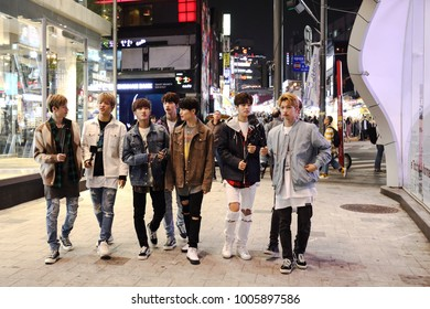 SEOUL, SOUTH KOREA - NOVEMBER 2, 2017: Teenagers walking along Hongdae district, a neighborhood known for its youthful ambience and underground culture, on November 2, 2017 in Seoul.