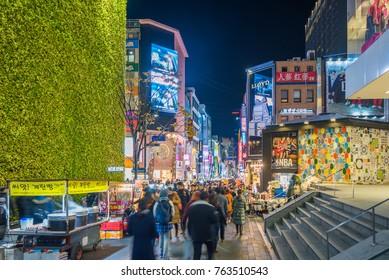 SEOUL, SOUTH KOREA - NOVEMBER 26, 2017 : People walking at  Myeong-dong shopping street at night, Seoul, South Korea