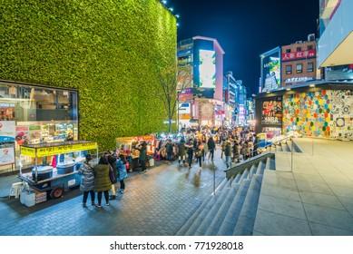 SEOUL, SOUTH KOREA - NOVEMBER 26, 2017 :Myeong-dong Market.People walking on a shopping street at night, Seoul, South Korea