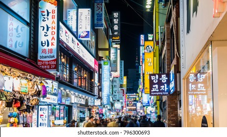SEOUL, SOUTH KOREA - NOVEMBER 26, 2017 : Myeong-dong Market.People walking on a shopping street at night, Seoul, South Korea