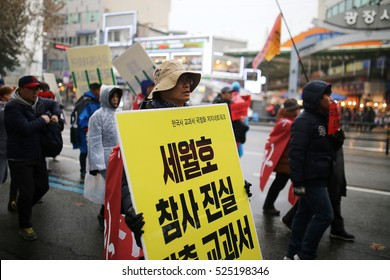 SEOUL, South Korea, November 26,2016 Group of protest South Koreans walk protested in the streets of their capital on past Saturday, demanding President Park Geun-hye's resignation