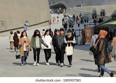 SEOUL, SOUTH KOREA – NOVEMBER 4, 2017: Young girls strolling along the Dongdaemun Design Plaza in Seoul's fashion district, on November 4, 2017 in Seoul.