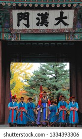 SEOUL, SOUTH KOREA - NOVEMBER 8, 2015: Armed guards in traditional costume guard the entry gate of Deoksugung Palace