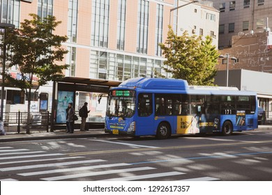 SEOUL SOUTH, KOREA - OCT, 27: Seoul city bus is driving to stop area around Ewha Womans University on October 27, 2018 in Seoul, South Korea