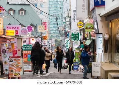 SEOUL SOUTH KOREA - OCT 31: Ewha shopping street, the famous shopping area around Ewha Womans University for female teenage on October 31, 2016 in Seoul, South Korea