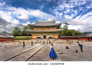 Seoul, South Korea - Oct 6th 2018 - Local dressing with traditional clothes in front of of a temple in Seoul in a blue sky day in South Korea