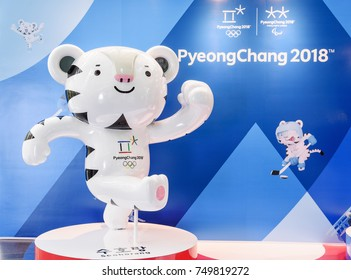 Seoul, South Korea - October 12, 2017: Mascot of the XXIII Olympic Winter Games. White tiger Soohorang is the official symbol of the 2018 Winter Olympics in PyeongChang. Logos of the 2018 Winter Games