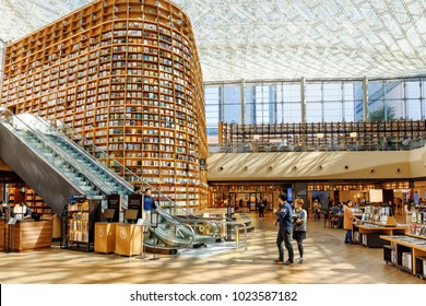 Seoul, South Korea - October 14, 2017: Amazing view of huge bookshelves and shelves with magazines in Starfield Library. The library is a popular destination among tourists and citizens of Seoul.