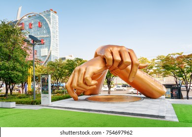 Seoul, South Korea - October 14, 2017: Statue of Gangnam Style is a new landmark of Gangnam District. The sculpture dedicated to the famous song among green trees on blue sky background on sunny day.