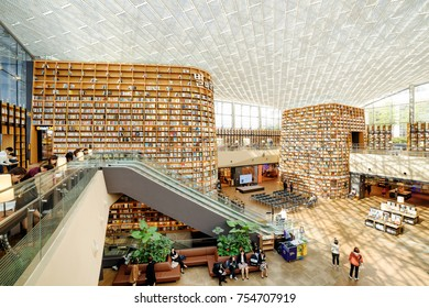 Seoul, South Korea - October 14, 2017: Amazing view of huge bookshelves in Starfield Library. Thousands of books and magazines are available for visitors to read in the popular public library.