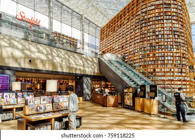 Seoul, South Korea - October 14, 2017: Huge bookshelves and shelves with magazines in Starfield Library at Gangnam District. The library is a popular destination among tourists and citizens of Seoul.