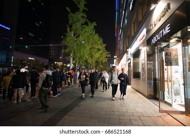 SEOUL, SOUTH KOREA - October 16, 2016: People in the walking street of the Myeong-dong shopping and entertainment district at night