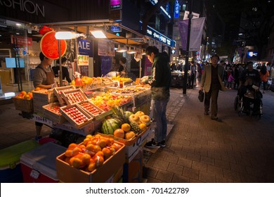 SEOUL, SOUTH KOREA - October 17, 2016: People walking in the shooping street of the Myeong-dong shopping and entertainment district at night
