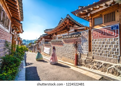 SEOUL, SOUTH KOREA - OCTOBER 18, 2018 : Unidentified tourists are traveling to traditional Korean style architecture at Bukchon Hanok Village in Seoul, South Korea.