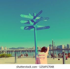Seoul, South Korea - OCTOBER 19, 2018:Women see map in Yeouido hangang park in autumn season, A famous park beside Han river.