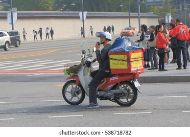 SEOUL SOUTH KOREA - OCTOBER 19, 2016: Unidentified man delivers mail in Seoul Korea.