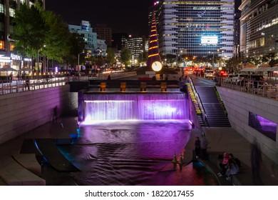 Seoul, South Korea - October 19th 2017: Cheonggye Plaza and the Cheonggyecheon Stream at night, Seoul, South Korea