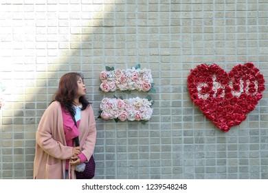 Seoul, South Korea - OCTOBER 20, 2018 : Young asian woman traveler traveling in hongdae shop street.