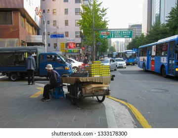 Seoul, South Korea, October 2012: shoe seller on the street for sale shoes and miscellaneous things to pedestrians