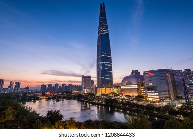 Seoul, South Korea - October, 2018: Night view of Lotte World Tower and Seokchon lake park in Seoul city.