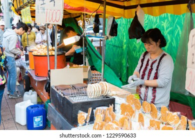 Seoul, South Korea - October 21, 2018 : Street Food for sale in Hongdae(Hongik University) shopping street. Hongdae is a shopping cultural street for young people in Seoul