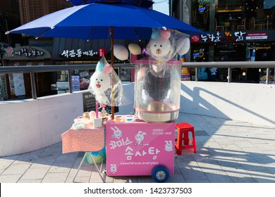 SEOUL, SOUTH KOREA - OCTOBER 21, 2018 :Cotton candy seller at Hongdae(Hongik University) shopping street. Hongdae is a shopping cultural street for young people in Seoul.