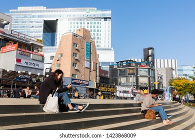 SEOUL, SOUTH KOREA - OCTOBER 21, 2018 : Walkable distance of hongdae is an area where many of street performances occur. Hongdae is a famous shopping and clubbing district in Seoul, South Korea.