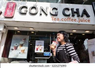 Seoul, South Korea - October 22, 2018 : Woman drink coffee on Gong Cha shops in Ewha Womans University, Korea. Gong Cha is a Taiwan-style tea drink shop and originally from Kaohsiung, Taiwan, China