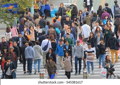 SEOUL SOUTH KOREA - OCTOBER 22, 2016: Unidentified people cross street in Seoul.