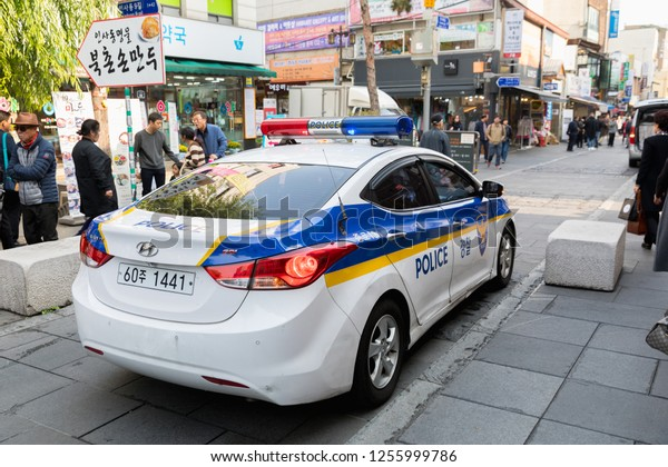 SEOUL, SOUTH KOREA - OCTOBER 23, 2018:Korean police car in Insadong street - the main street of the Insadong area in Seoul. It is a large market for antiques and artworks and a popular shopping area