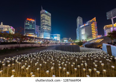 Seoul, South Korea - October 24, 2018:  LED roses flower garden and Korea at night colorful city in Dongdaemun shopping area in Seoul, South Korea.