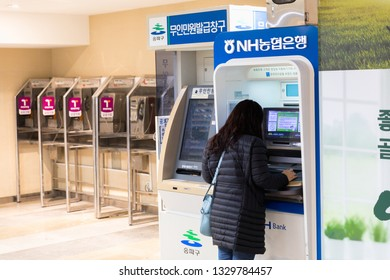 Seoul, South Korea - October 27, 2018 : Woman press cash at Bank ATM cash machine at subway in Seoul. South Korea.