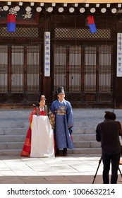 SEOUL, SOUTH KOREA - OCTOBER 29, 2017: Photographer taking pictures of bride and groom wearing hanbok at a traditional Korean wedding on October 29, 2017 in Seoul.