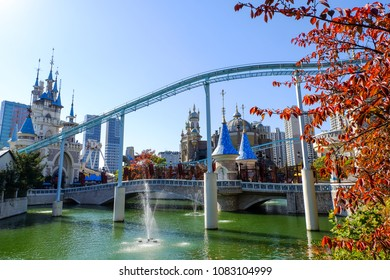Seoul, South Korea - october 30, 2017: Lotte World amusement theme park around Seokchon lake with clear blue sky in autumn, a major tourist attraction in Seoul, South Korea.