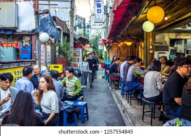 Seoul, South Korea - Sept 10th 2018 - Big group of people having dinner in a open and simple local restaurant in Seoul in South Korea