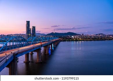SEOUL, SOUTH KOREA SEPTEMBER 02,2018:BANPO HANGANG PARK,Beautiful lights Dongjak Bridge on Hangang River and Seoul Tower at South Korea.