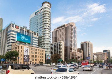 SEOUL, SOUTH KOREA - SEPTEMBER 12, 2015: Cars and buses drive along Seoul main avenue in the business district of South Korea capital city.