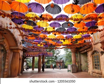 Seoul, South Korea - September 18, 2018 : Aesop umbrella alley which have the hundreds of colorful umbrellas and halloween pumpkin and doll in the Everland theme fun park